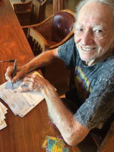 willie-signing-checks